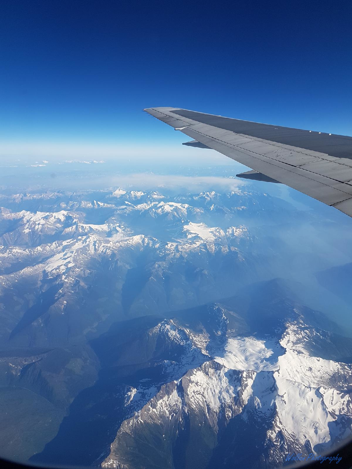 The world below - View out the window of the air canada flight by Alana